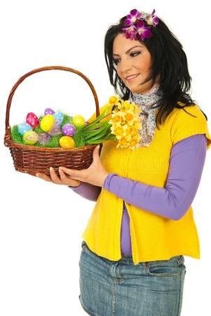 Beauty woman holding and looking at Easter basket isolated on white background photo