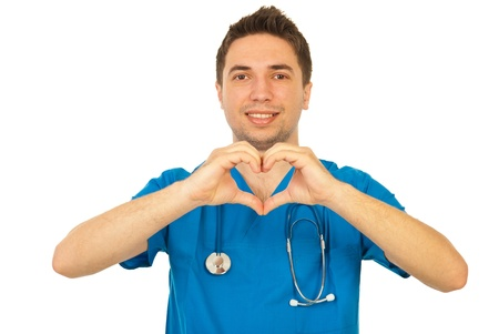 Happy doctor man showing heart shape isolated on white background Stock Photo - 13240635