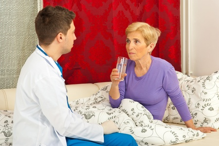 house coats: Doctor man talking with sick patient home
