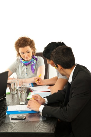 Three business people working at meeting and sitting at table isolated on white background photo