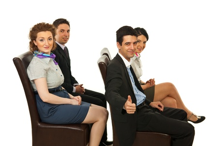 people sitting on chair: Successful four business sitting on chairs to a side and looking camera isolated on white background Stock Photo