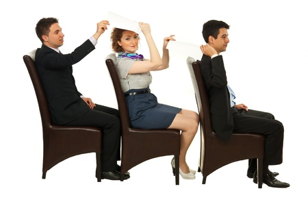 see side: Business people sitting in a line on chairs and giving papers to each other isolated on white background