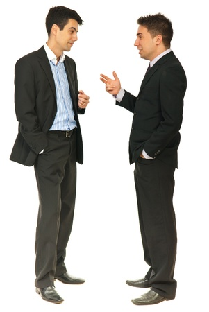discuss: Full length of two business men having conversation together isolated on white background
