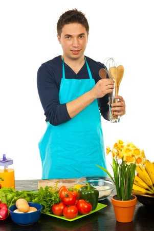 Man choice kitchen utensil and preparing to cook photo