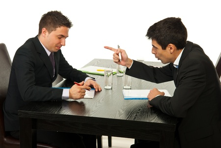 Two business men having discussion at meeting photo