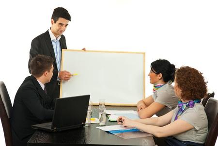 ing: Young business man hav ing presentation on blank board at meeting