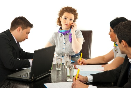Worried manager woman talking by phone mobile and having meeting photo