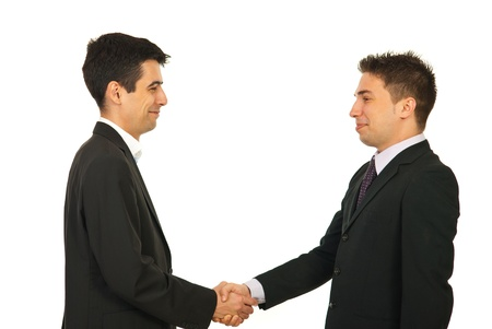 Happy two business men giving hand shake and smiling isolated onw hite background photo