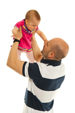 to raise: Father raising baby girl over his head isolated on white background Stock Photo