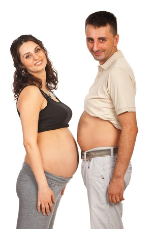 Happy future parents standing with their bellys  face to face isolated on white background Stock Photo - 15043238