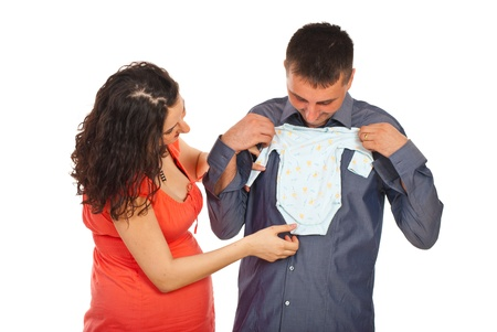 Future parents holding and looking to first baby's cloth for their baby isolated n white background photo