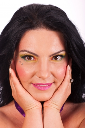 Beauty woman with creative make up holding her face in hands and smile photo