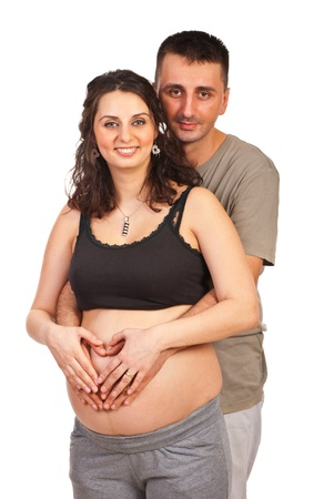 Loving future parents make heart shape with hands on pregnant tummy Stock Photo - 15609166