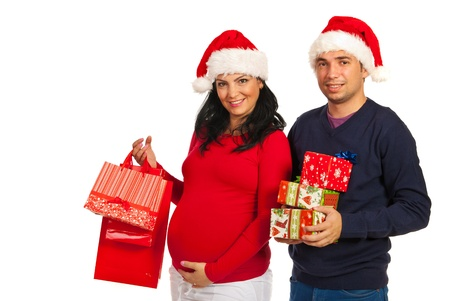 Pregnant woman and her husband holding Christmas gifts islated on white background Stock Photo - 16063530