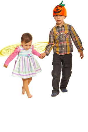 kids holding hands: Walking kids  with Halloween outfits isolated on white background