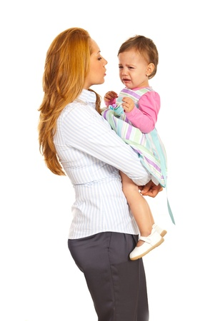 Business woman talking with her crying toddler girl isolated on white background