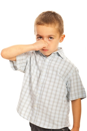 Boy holding his nose to not smell isolated on white background Stock Photo - 16120152