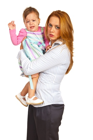 Exhausted mother businesswoman holding  crying girl isolated on white background
