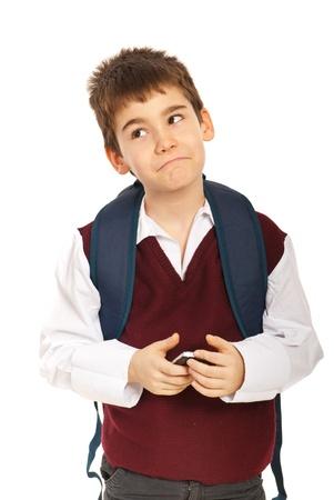 Confused thinking schoolboy holding phone mobile isolated on white background photo