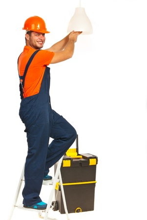 Smiling electrician working change a bulb isolated on white background photo