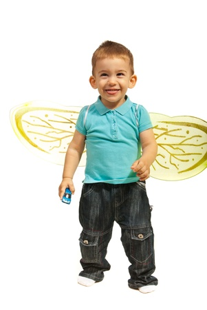Funny little boy with bee wings taking tongue out  photo