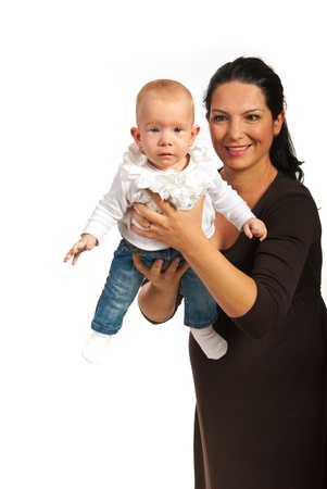 mom holding baby: Mother playing with her  baby girl isolated on white background