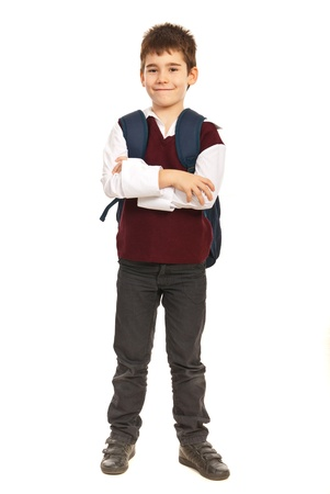 folded hands: Full length of student boy at primary school with back bag standing  with arms folded isolated on white background Stock Photo