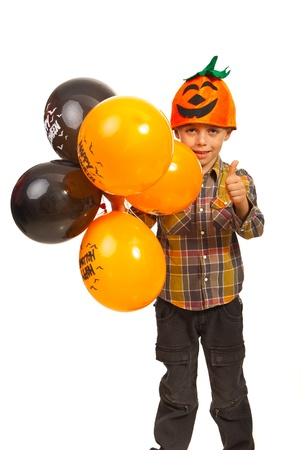 Successful kid wearing pumpkin hat,holding Halloween and giving thumb up isolated on white background Stock Photo - 16141841