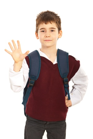 five fingers: Schoolboy showing five fingers isolated on white background