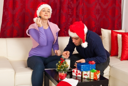 Couple enjoying Christmas night together and eating biscuits together  photo