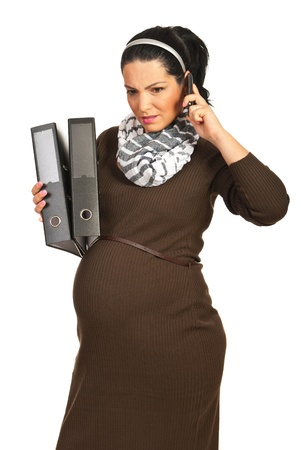Business pregnant woman receiving bad news by phone mobile isolated on white background photo