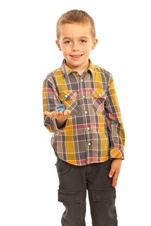 one little boy: Happy boy showing a toy car isolated on white background