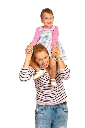 Mother giving piggy back to her daughter and laughing togheter isolated onw hite background photo