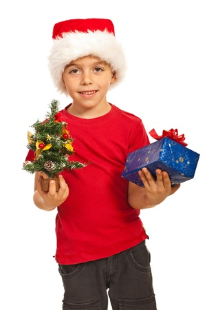 Happy boy with Santa hat holding Christmas tiny tree and gift isolated on white background Stock Photo - 16236570