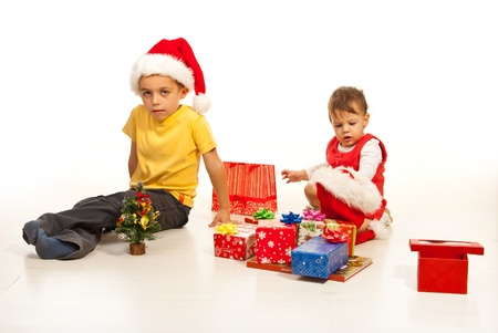 Happy two kids preparing for Christmas with many presents and sitting on floor Stock Photo - 16236558