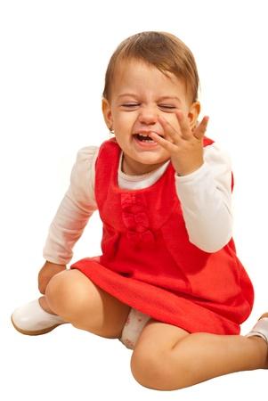 laughing out loud: Chica ni�o sentado y ri�ndose a carcajadas y estar en movimiento aislado en el fondo blanco Foto de archivo