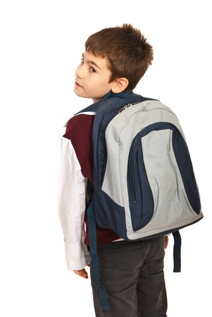 Student boy with  bag looking back over shoulder  isolated on white background Foto de archivo
