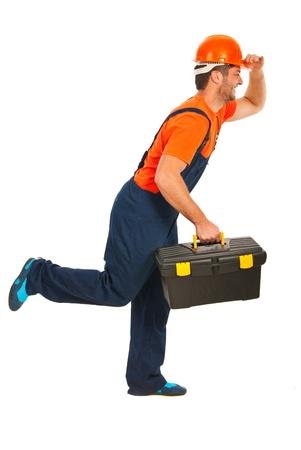 Running workman holding tool box isolated on white background photo