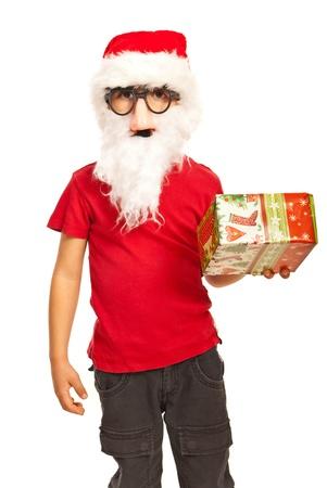 Christmas boy wearing Santa hat ,mask and beard  holding gift isolated on white background Stock Photo - 16300586