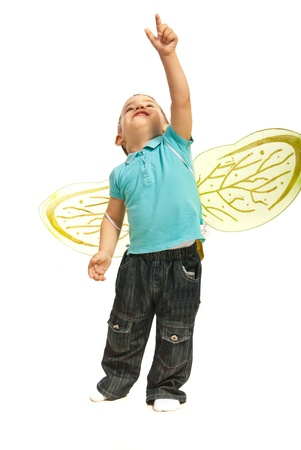 Toddler boy with bee wings pointing up isolated on white background