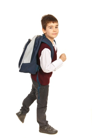 Walking school boy  being in a hurry isolated on white background photo