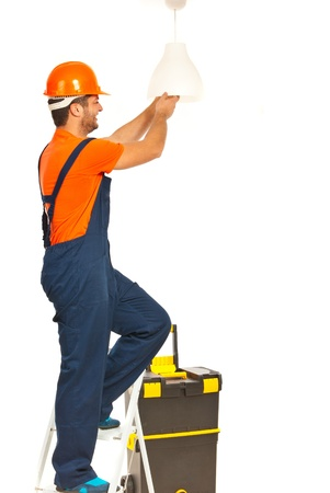 stepladder: Electrician worker man working and changing a bulb isolated on white background