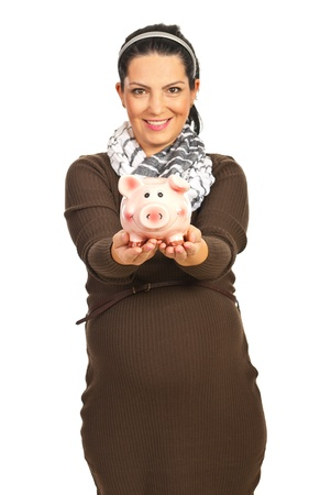 Casual pregnant woman giving piggy bank isolated on white background photo