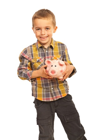 Happy boy holding piggy bank isolated on white background Stock Photo - 16379307