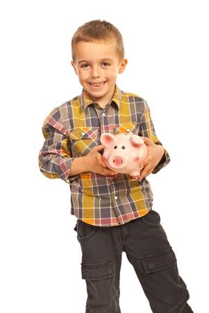 Happy boy holding piggy bank isolated on white background Stock Photo - 16379307