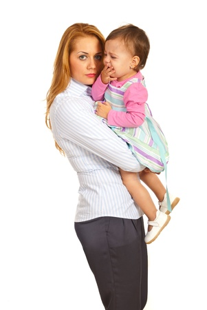 Business woman mother holding crying toddler girl isolated on white background photo