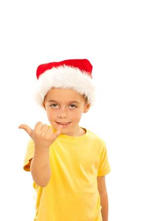 Cute littl kid boy with santa hat gesticulate with fingers surfer gesture Stock Photo - 16379208