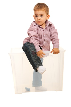coming out: Full length of boy coming out from a transparent box isolated on white background