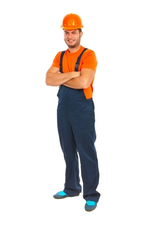 folded hands: Cheerful constructor worker man with arms folded isolated on white background