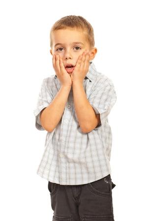 scared child: Amazed child boy holding hands on face isolated on white background Stock Photo